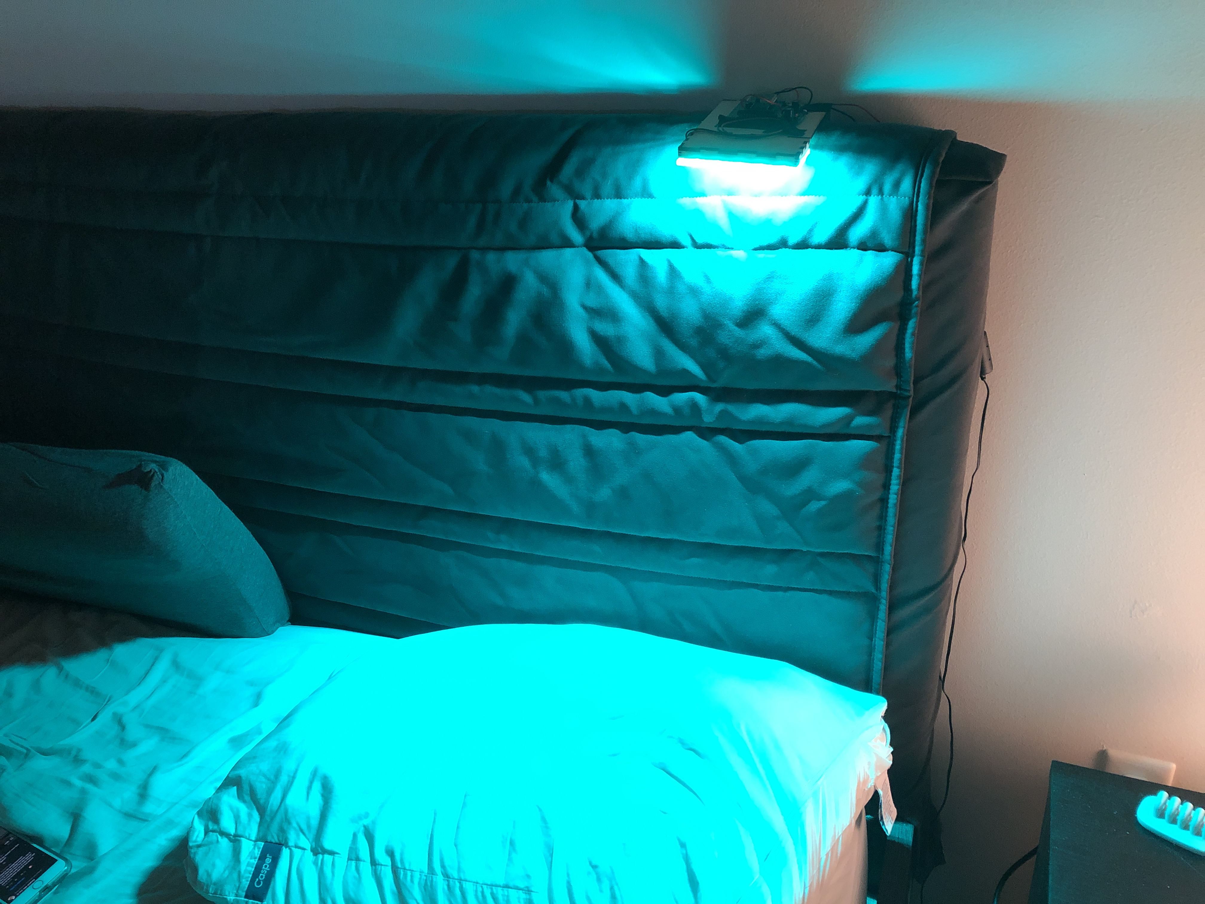Lights mounted above bed